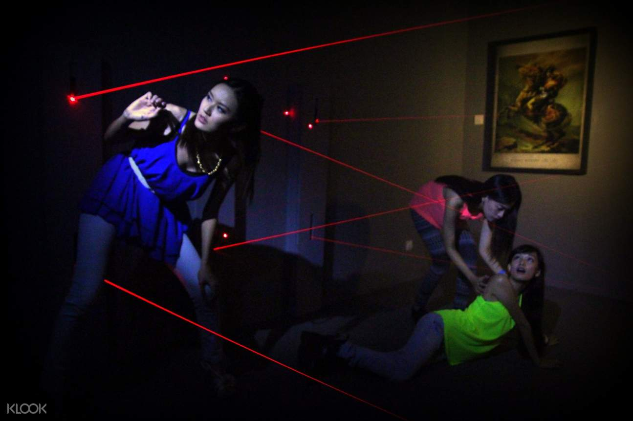 Woman dodging lasers in Escape Room Kuala Lumpur